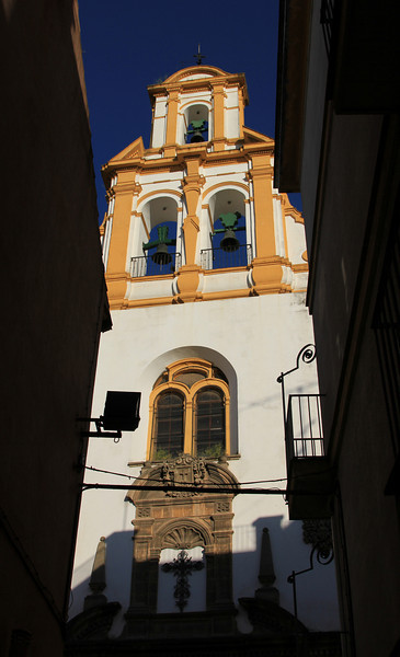 Bell tower of small church in Santa Cruz (historic Seville),