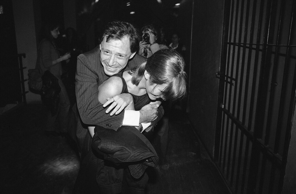 . As they enter the Underground disco in New York for a party for Henry Mancini, singer Eddie Fisher tries to get actress daughter Carrie Fisher to pose for the waiting photographers, April 24, 1981 Carrie doesn\'t want to and the loving father loses this one. (AP Photo/Richard Drew)