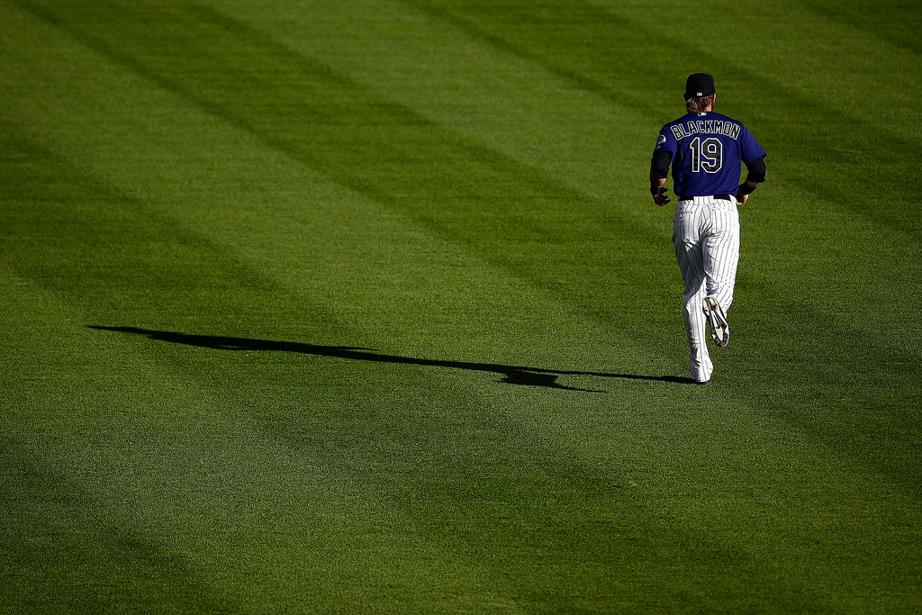 . Charlie Blackmon (19) of the Colorado Rockies jogs across the field before the action started at Coors Field. Major League Baseball action between the Colorado Rockies and the Washington Nationals on Monday, July 21, 2014. (Photo by AAron Ontiveroz/The Denver Post)