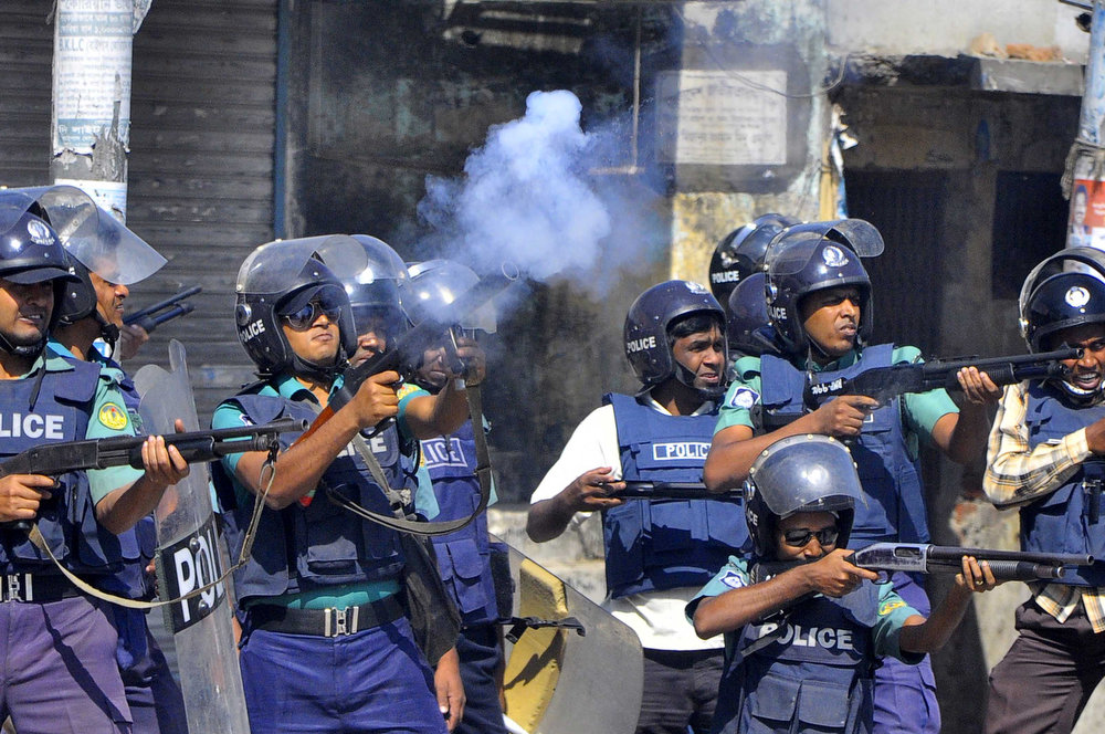. Bangladeshi police officials fire rubber bullets and teargas shells towards demonstrators during a clash with Jamaat-e-Islami activists in the north western city of Rajshahi, about 260 kms from the capital Dhaka, on March 1, 2013.   The number of people killed in clashes in Bangladesh over the conviction of Islamist leaders for war crimes rose to 53 on Friday, as fresh outbursts of violence erupted.   STR/AFP/Getty Images