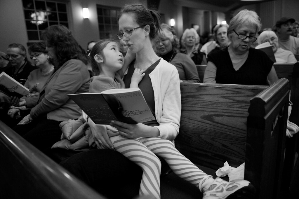 """. Cassandra Eichenberger comforts her daughter, Athena, 5, during the Denver Philharmonic Orchestra concert at the KPOF Concert Hall in Denver, CO, Friday December 14, 2012. The pair was there to see Cassandra\'s sister, Taryn Galow, play bass with the community orchestra, \""""I loved the concert. That was my first time seeing the Denver Philharmonic... There\'s something about an intimate space, the music fills up the whole place.\"""" She said, \""""I want to expose my children to all forms of art. Honestly, kids need to see creativity at it\'s finest... I\'m trying to provide that culture to my children - whether it be classical music, theater or dance. If they don\'t like it, that\'s fine, I just want to offer them a creative outlet.\"""" The ticket prices help make that happen. \""""The Denver Philharmonic didn\'t charge for children. They\'re introducing them to music and giving them their first taste.\"""" Craig F. Walker, The Denver Post"""