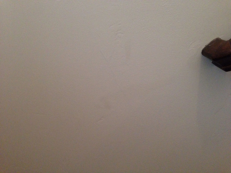 damaged wall - entry foyer (main fl)