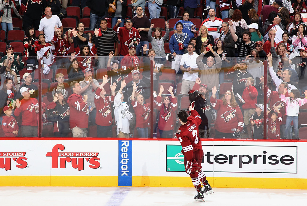 . GLENDALE, AZ - APRIL 26:  Keith Yandle #3 of the Phoenix Coyotes throws a hat to the fans following the NHL game against the Colorado Avalanche at Jobing.com Arena on April 26, 2013 in Glendale, Arizona. The Avalanche defeated the Coyotes 5-4 in an overtime shoot-out.  (Photo by Christian Petersen/Getty Images)