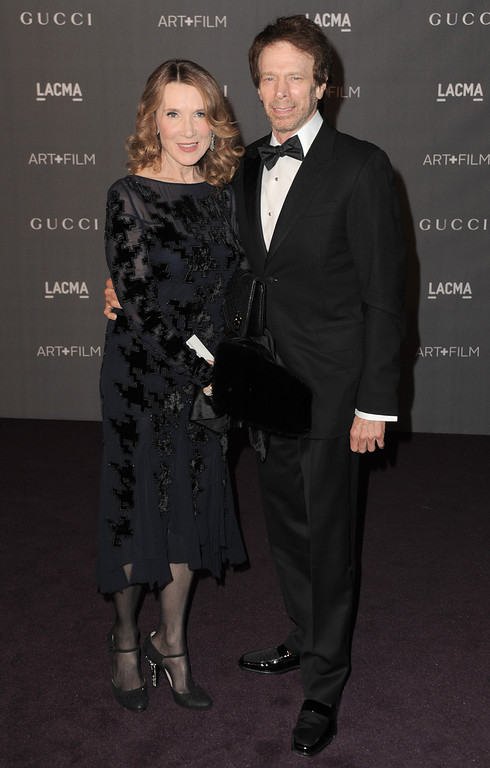 . Linda Bruckheimer, left, and Jerry Bruckheimer arrive at the 2012 ART + FILM GALA hosted by LACMA on Saturday, Oct. 27, 2012, in Los Angeles. (Photo by Jordan Strauss/Invision/AP)