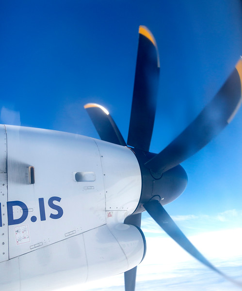 The Bombardier's 6-bladed propeller is frozen at 1/8000th second.