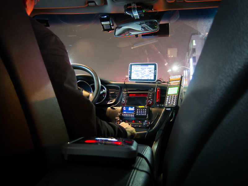 Typical South Korean taxi with massive GPS that doubles as a TV (often acting as both at the same time while driving), credit card and metro pass reader on the arm rest, and an assortment of other devices.