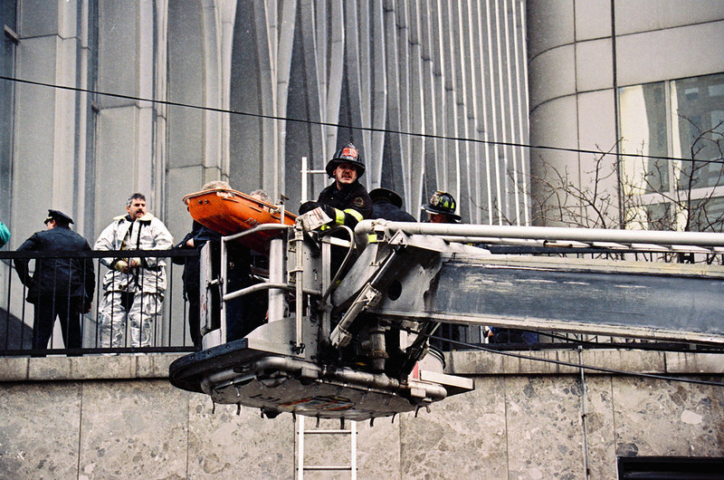 . Firefighters in a cherry picker remove an explosion victim on a gurney outside one of the World Trade Center\'s twin towers in New York, after an explosion rocked the complex.  (AP Photo/Alex Brandon, File)
