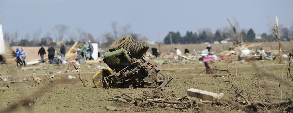 . A tractor is overturned near the Cherry Hill subdivision outside of Flagg Center, Ill., on Friday, April 10, 2015.  A tornado hit the town of Fairdale, Ill., Thursday night killing two people. The National Weather Service says at least two tornadoes churned through six north-central Illinois counties. (AP Photo/Matt Marton)