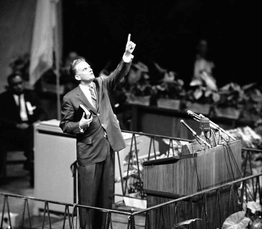 ". Evangelist Billy Graham is shown speaking at Madison Square Garden, New York City  May 15, 1957 as he opens his crusade for ""A Spiritual Revolution in the City.\"" (AP Photo)"