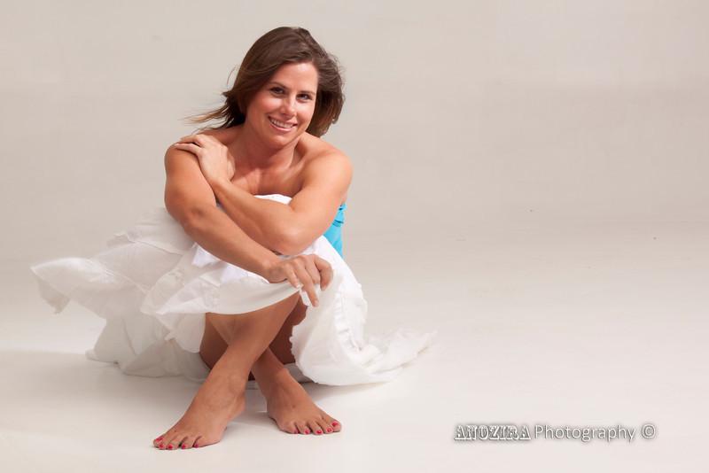 Sitting_White Skirt_Blue Top_Denise.jpg