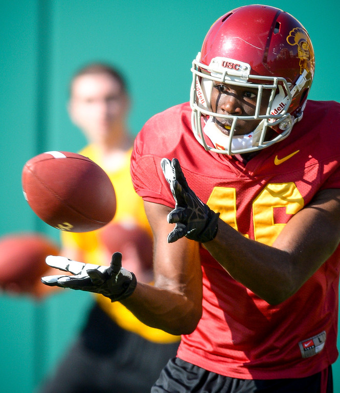 . USC�s Aaron Minor pulls in a pass during spring practice at USC Tuesday, April 15, 2014.  (Photo by David Crane/Los Angeles Daily News.)
