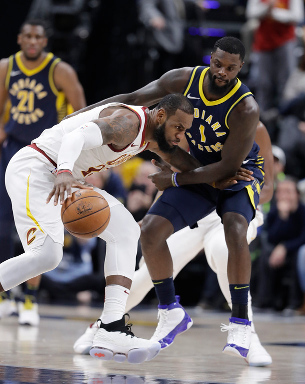 . Cleveland Cavaliers\' LeBron James (23) is defended by Indiana Pacers\' Lance Stephenson during the second half of an NBA basketball game, Friday, Jan. 12, 2018, in Indianapolis. (AP Photo/Darron Cummings)