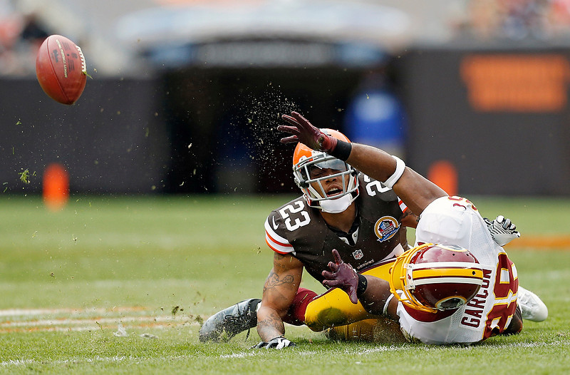 . Cleveland Browns cornerback Joe Haden (23) breaks up a pass intended for Washington Redskins wide receiver Pierre Garcon in the first quarter of an NFL football game in Cleveland, Sunday, Dec. 16, 2012. (AP Photo/Rick Osentoski)