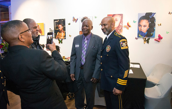 02/28/20 Wesley Bunnell | StaffrrTwenty five men were honored at Gallery 66 on Friday night for their involvement in the community as part of Black History Month. Honrees Arnold Black, L, and CCSU Police Chief Gregory Sneed pose for a photo.