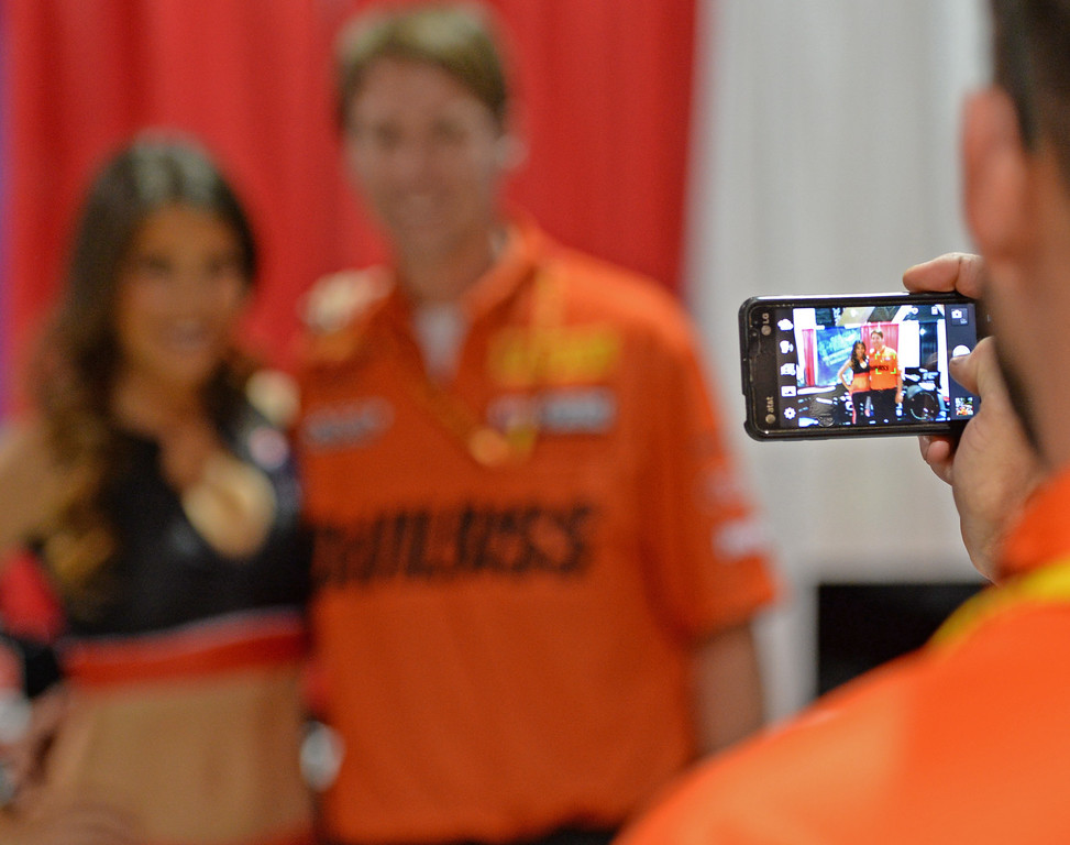 . People were able to take photos with models in the Lifestyle Expo of the Toyota Grand Prix of Long Beach Friday, April 17, 2015, Long Beach, CA.   Photo by Steve McCrank/Staff Photographer