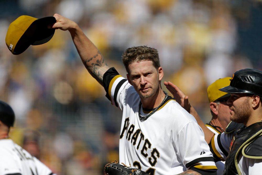 . Pittsburgh Pirates starting pitcher A.J. Burnett, left, and catcher Russell Martin celebrate Burnett\'s complete game 5-1 win over the Colorado Rockies in a baseball game in Pittsburgh Sunday, Aug. 4, 2013. (AP Photo/Gene J. Puskar)