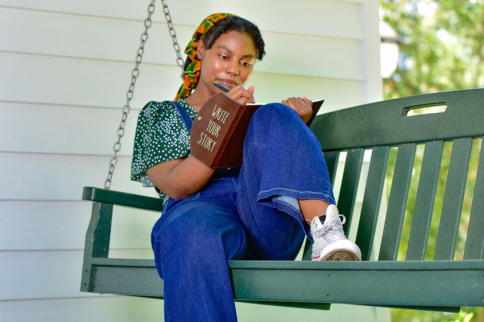 Jonesha Johnson writes in her journal. Photo credit: Kevin Dantes courtesy of Black Farmers' Network