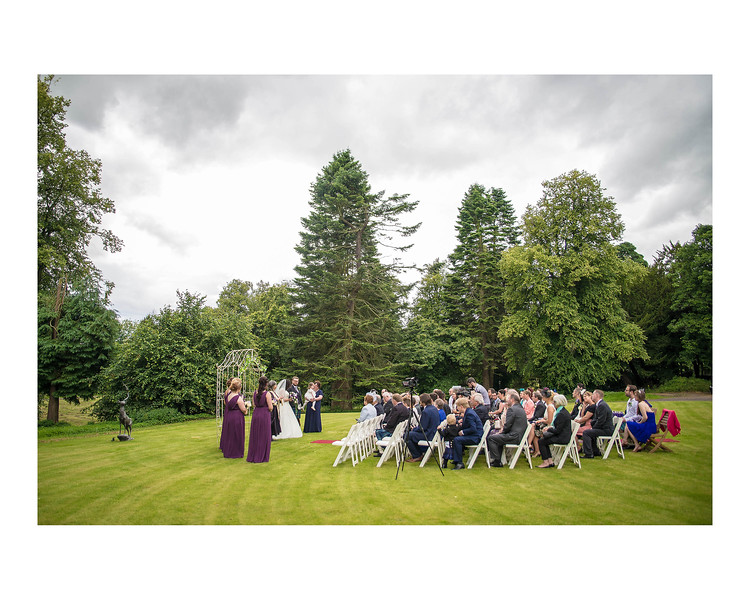 Wedding Photography of Sara & Andrew, Fernie Castle, Cooper, Fife, Photograph is of the ceremony on the lawn