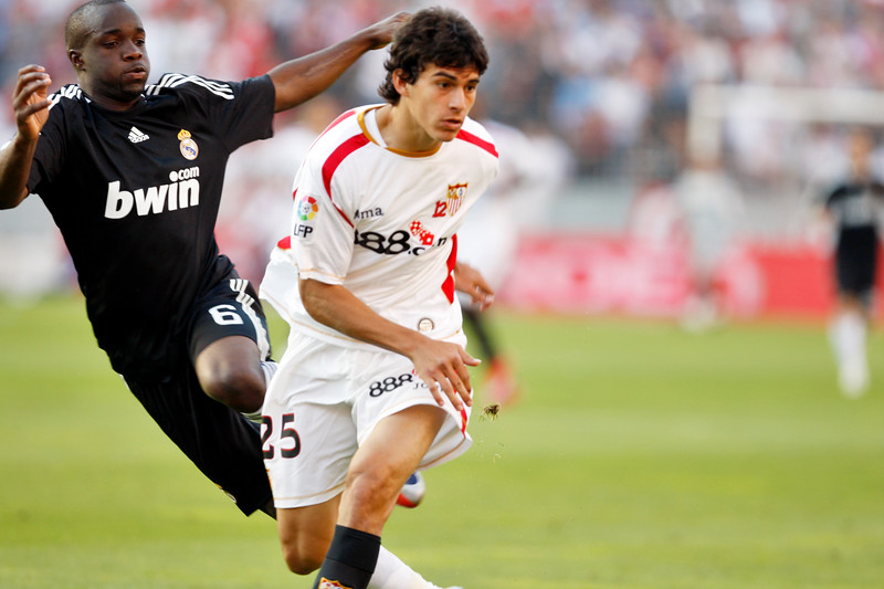 Perotti (Sevilla) pursued by Lass (R. Madrid). Spanish Liga football game between Sevilla FC and Real Madrid CF that took place at Sanchez Pizjuan stadium, Seville, Spain, on 26 April 2009