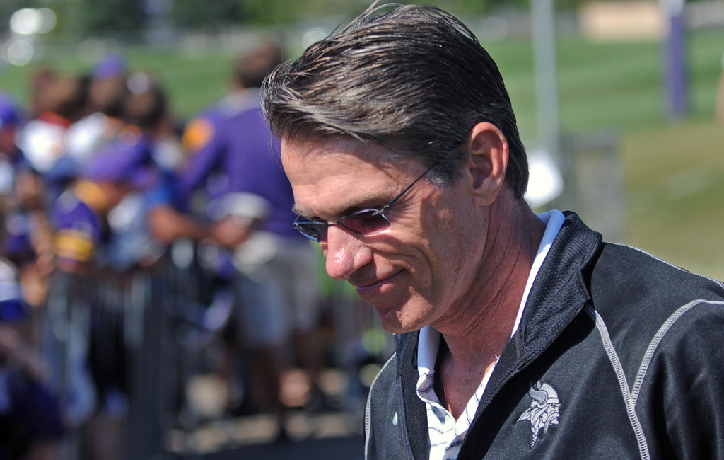 . Vikings General Manager Rick Spielman walks onto the practice field on the last day of training camp. (Pioneer Press: Chris Polydoroff)