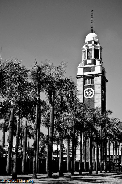 This is the famous Clock Tower in Tsim Sha Tsui, formerly part of the Kowloon train station (九龍車站), which was replaced by the Hong Kong Cultural Centre. However, the Clock Tower remains.