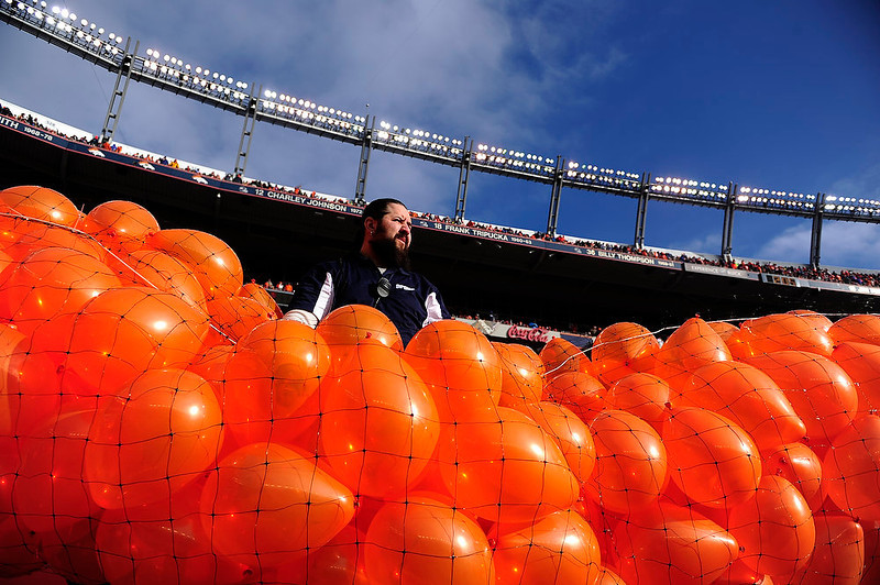 . Chris Montez gets ready to release the orange balloons before the start of the game. The Denver Broncos vs Baltimore Ravens AFC Divisional playoff game at Sports Authority Field Saturday January 12, 2013. (Photo by AAron  Ontiveroz,/The Denver Post)
