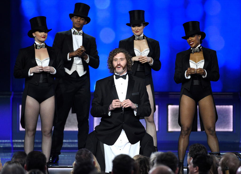 . Host T.J. Miller, center, performs at the 22nd annual Critics\' Choice Awards at the Barker Hangar on Sunday, Dec. 11, 2016, in Santa Monica, Calif. (Photo by Chris Pizzello/Invision/AP)
