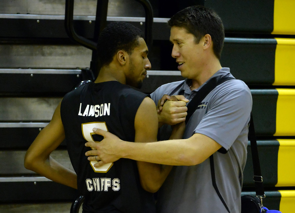 . Santa Fe head coach Chris Komer consoles Calvin Lawson (5) as Damien defeated Santa Fe 25-17, 25-19, 29-27 during a prep semifinal volleyball match at Damien High School in La Verne, Calif., on Wednesday, May 20, 2015. (Photo by Keith Birmingham/ Pasadena Star-News)
