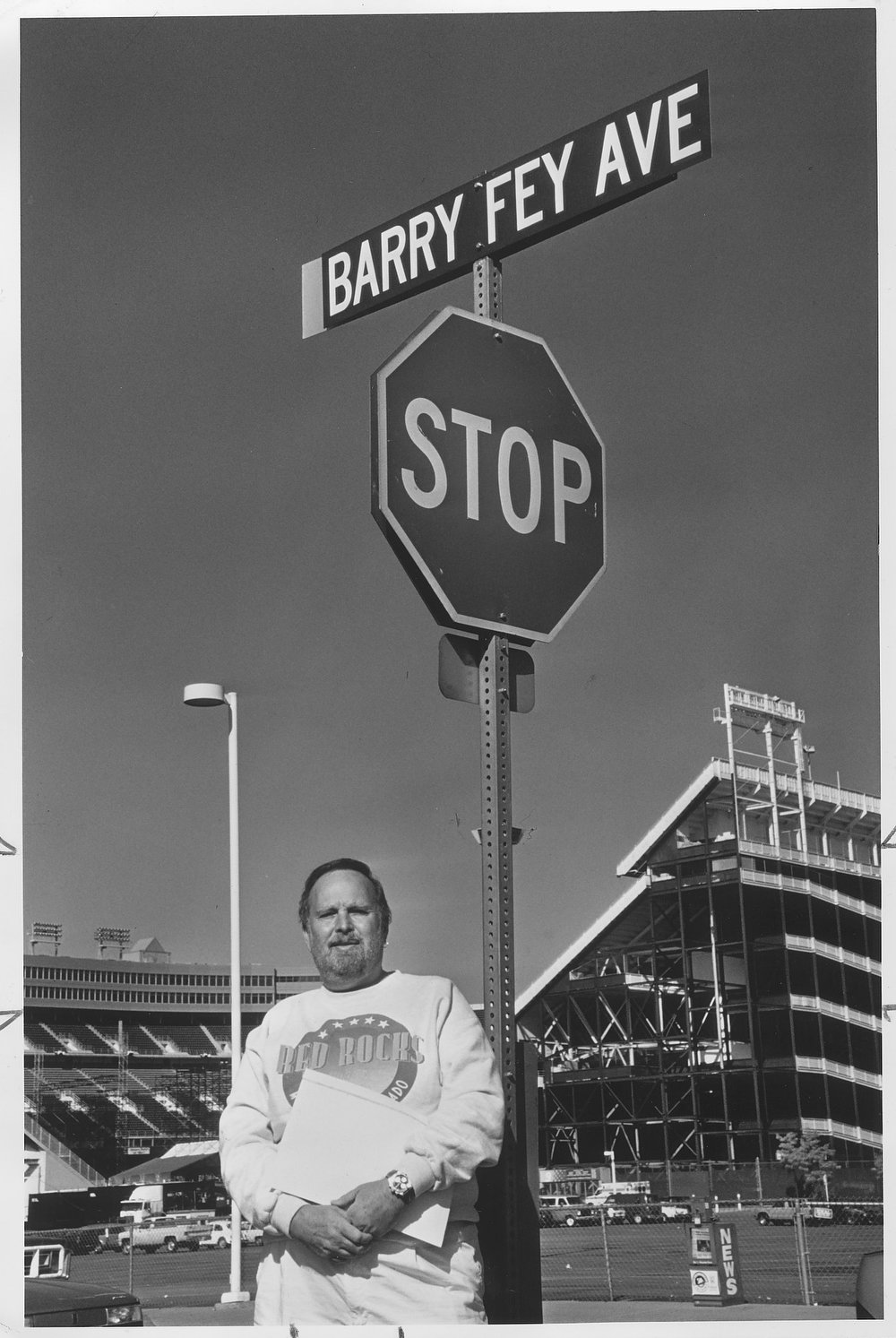 . This photo was taken 10-21-92.  Barry Fey stands beneath a sign temporary naming West 17th Ave. between Mile High Stadium and McNichol arena in his honor.  (John Prieto/The Denver Post)