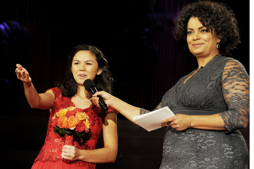 """. Rose Princess Jamie Ann Kwong, introducing her family while being interviewed by Michaela Pereira, CNN News Anchor, \""""New Day\"""" during, Tournament of Roses Announcement and Coronation of the 96th Rose Queen and Presentation of the 2014 Royal Court held at First Church of the Nazarene of PasadenaThursday, October 24, 2013. (Photo by Walt Mancini/Pasadena Star-News)"""