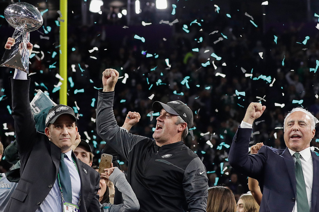 . Philadelphia Eagles general manager Howie Roseman, left, holds up the Vince Lombardi Trophy as he celebrates with head coach Doug Pederson, center, and owner Jeffrey Lurie after the NFL Super Bowl 52 football game against the New England Patriots, Sunday, Feb. 4, 2018, in Minneapolis. The Eagles won 41-33. (AP Photo/Matt Slocum)