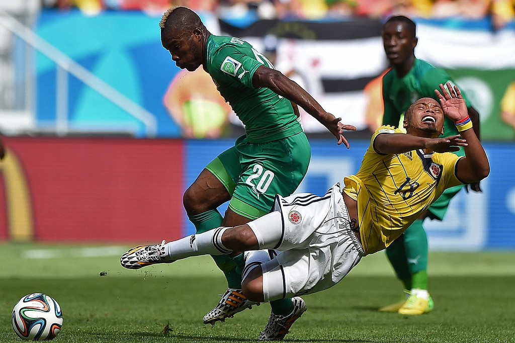 . Ivory Coast\'s midfielder Geoffroy Serey Die (L) fights for the ball with Colombia\'s defender Juan Camilo Zuniga during a Group C football match between Colombia and Ivory Coast at the Mane Garrincha National Stadium in Brasilia during the 2014 FIFA World Cup on June 19, 2014. EITAN ABRAMOVICH/AFP/Getty Images