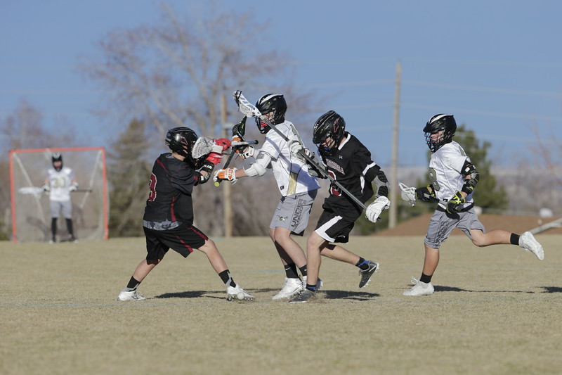 JPM0256-JPM0256-Jonathan first HS lacrosse game March 9th.jpg
