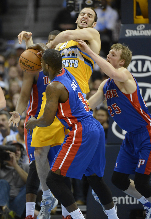 . Detroit Pistons Rodney Stuckey (3) knocks the ball out of the hands of Denver Nuggets Kosta Koufos (41)  during the fourth quarter Tuesday, November 6, 2012 at Pepsi Center.  John Leyba, Denver Post