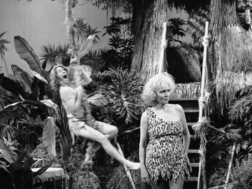 . Actress Betty White, alias Jane, stands in wait for her man, Tarzan, alias Johnny Carson, during a sketch on NBC-TV?s ?The Tonight Show? in Los Angeles, Friday, August 14, 1981. The swinging duo were joined in the skit by the Mighty Carson Art Players and were aided by a brilliant jungle set designed by John Shrum, who recently was nominated for an Emmy for his work on the show. (AP Photo)