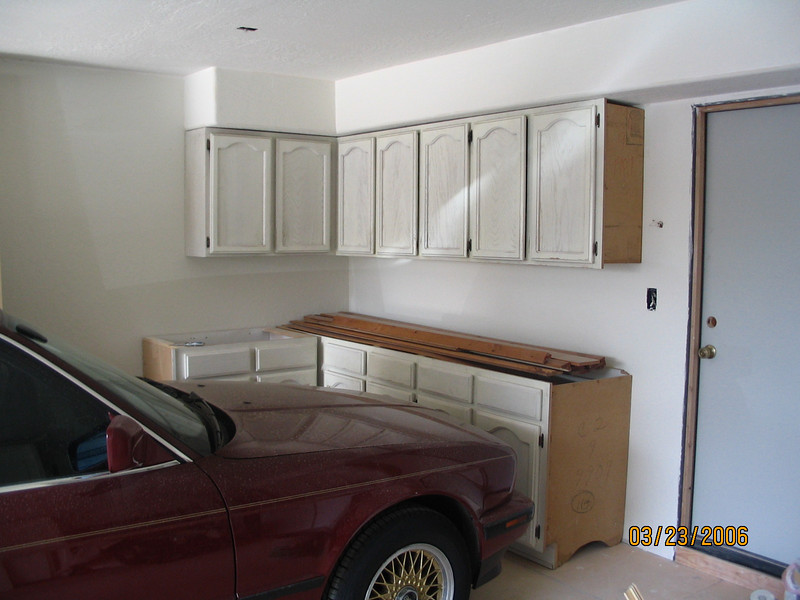 We took the old, white kitchen cabinets and hung them in the garage.