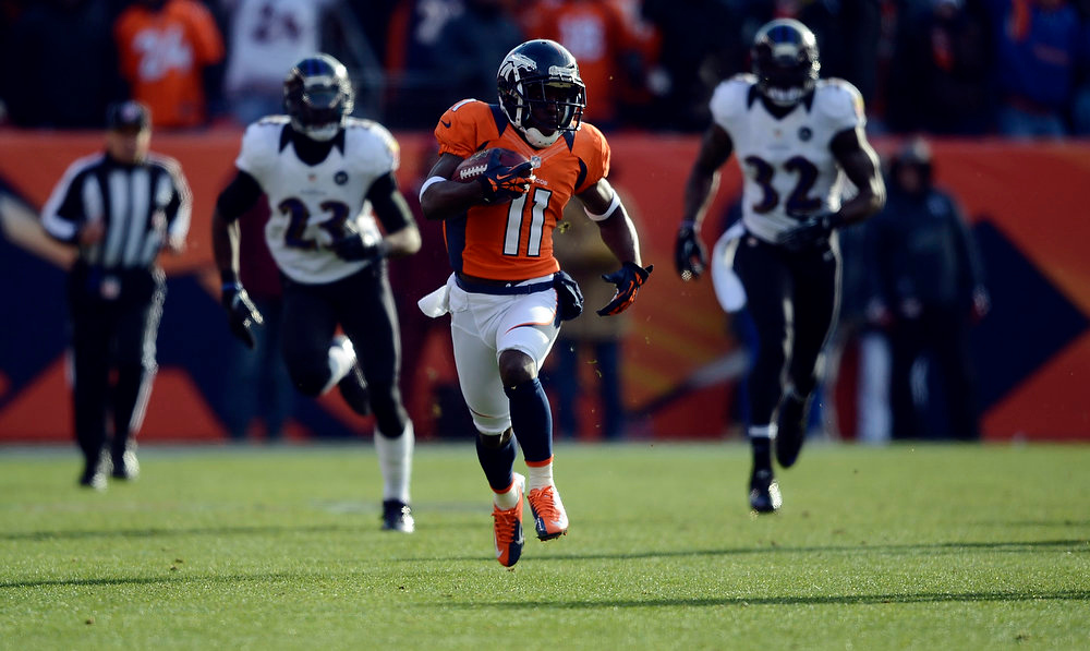 Description of . Denver Broncos wide receiver Trindon Holliday (11) runs in an 89 yard punt return for a touchdown early in the first quarter.  The Denver Broncos vs Baltimore Ravens AFC Divisional playoff game at Sports Authority Field Saturday January 12, 2013. (Photo by Hyoung Chang,/The Denver Post)