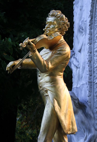 """A statue of Vienna's famous classical composer Johann Strauss. First photo taken in the soft light of dawn on """"Church Marathon Day"""", the focus of this gallery."""