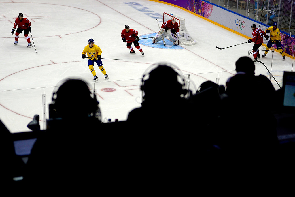 . Sweden and Switzerland square off during the action at Bolshoy Arena. Sochi 2014 Winter Olympics on Friday, February 14, 2014. (Photo by AAron Ontiveroz/The Denver Post)