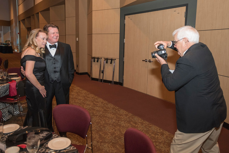 Distinguished Alumni Michael Finney (center) with guests and honorees enjoy the Distinguished Alumni Dinner on Friday, March 24, 2017 in Chico, Calif. (Jason Halley/University Photographer)