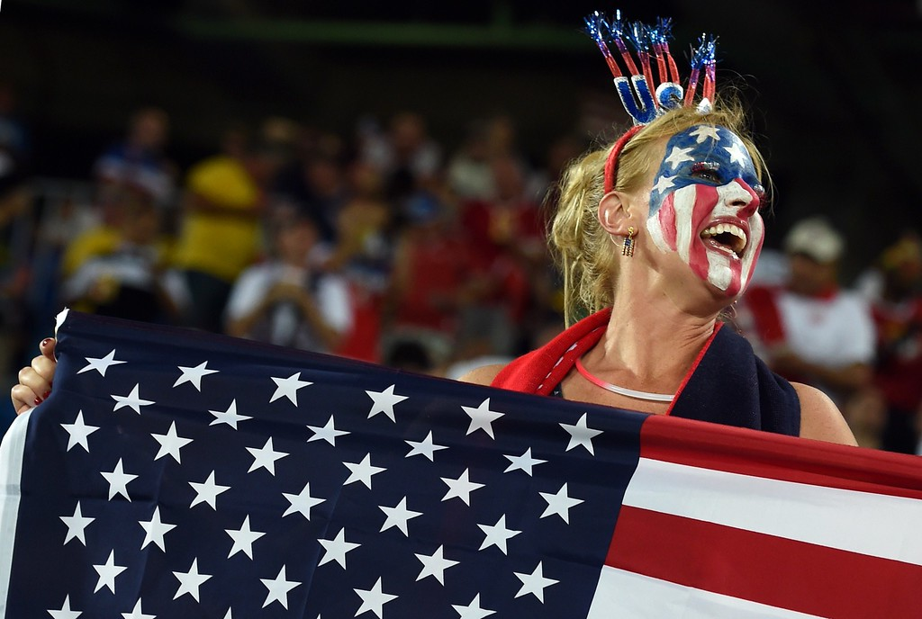 . An US fans cheers before before the Group G football match between Ghana and US at the Dunas Arena in Natal during the 2014 FIFA World Cup on June 16, 2014.  AFP PHOTO / CARL  DE SOUZA/AFP/Getty Images