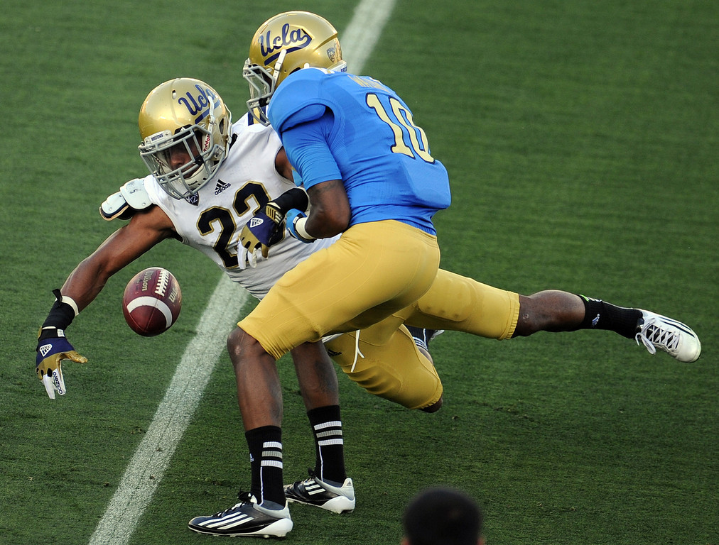 . UCLA cornerback Anthony Jefferson (23) breaks-up a pass intenedted for Kenneth Walker (10) during the football spring showcase college football game in the Rose Bowl on Saturday, April 27, 2013 in Pasadena, Calif.    (Keith Birmingham Pasadena Star-News)
