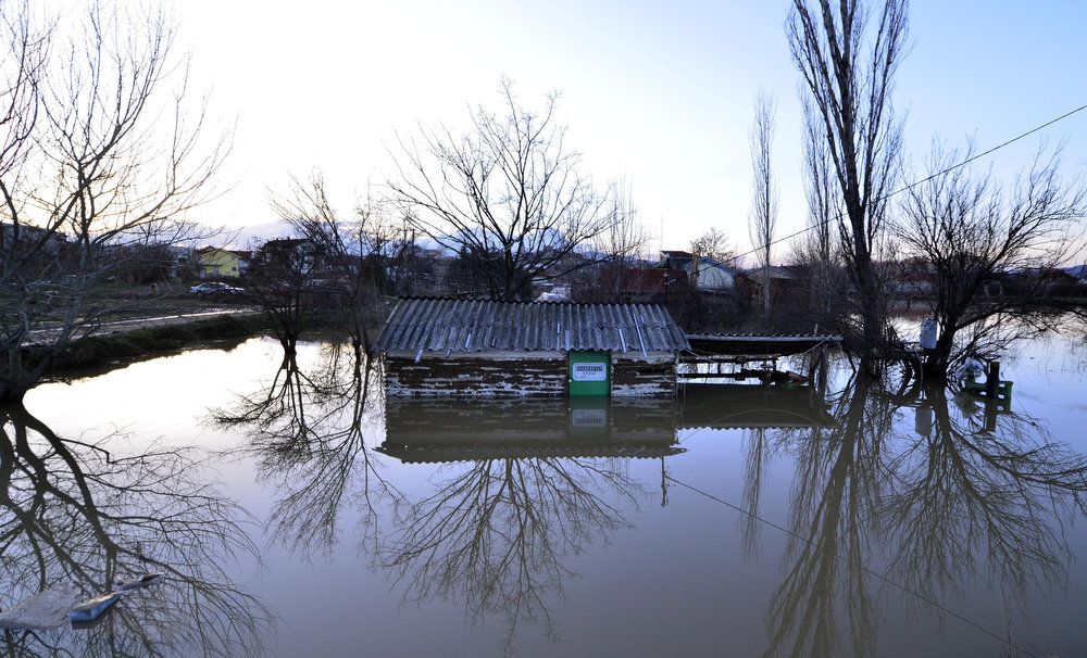 Description of . A stonecutter's workshop is seen flooded after heavy rain in Sveti Nikole, central Macedonia, on Tuesday, Feb. 26, 2013. Extensive flooding has hit Macedonia after three days of heavy rain, leaving one man dead, bridges wiped out and homes and fields inundated Tuesday. Police said a 51-year-old man drowned in the northern town of Kumanovo after being swept away Monday while trying to cross a river. His body was discovered Tuesday by rescue crews in the mountainous Balkan nation. (AP Photo/Boris Grdanoski)