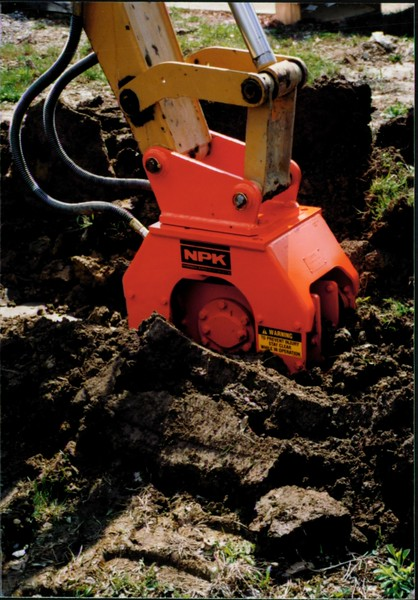 NPK C4C compactor with narrow baseplate on backhoe at NPKCE (6).JPG