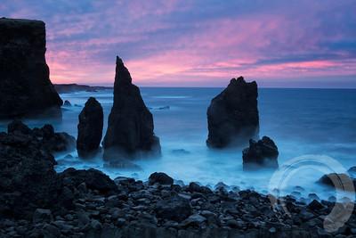 Sunrise at sea stacks not far from Keflavik.
