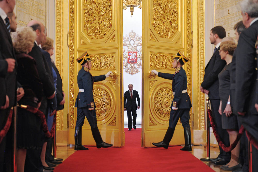 Description of . Russia's President Vladimir Putin (C) enters Andreyevsky (St.Andrew's ) Hall at the Great Kremlin Palace in Moscow's Kremlin, on May 7, 2012, during his inauguration ceremony. Putin took his oath of office today to become Russia's president for a historic third mandate at a glittering ceremony inside the Kremlin. AFP PHOTO/ RIA-NOVOSTI/ ALEXEY  DRUZHININ/AFP/Getty Images