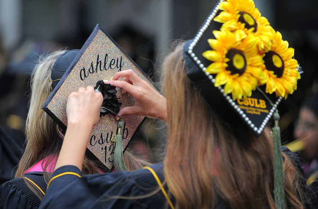 . LONG BEACH - CSULB began with the first of nine graduation ceremonies that will take place through Friday on the upper campus quad. The College of Heath & Human Services were the first to graduate on Wednesday with student receiving their degrees in Communicative Disorders, Criminal Justice, Family and Consumer Sciences, Recreation and Leisure Studies and Social Work. 05/22/2013  (Photo: Scott Varley/Daily Breeze)