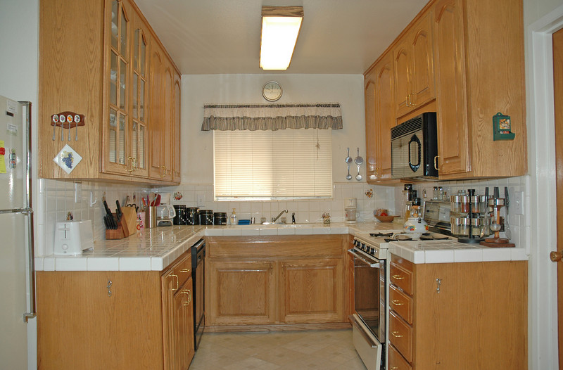 Remodeled kitchen that features oak cabinets, gas stove, dishwasher and built-in microwave.