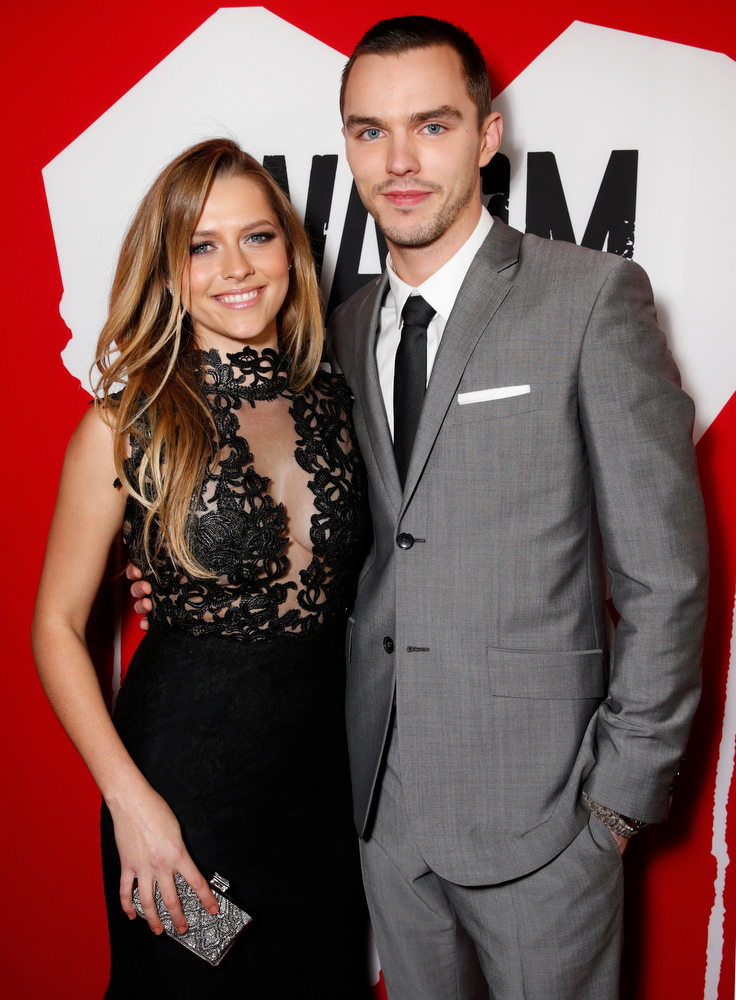 "Description of . Teresa Palmer and Nicholas Hoult attends the LA Premiere of ""Warm Bodies\"" at the ArcLight Cinerama Dome on Tuesday, Jan. 29, 2013 in Los Angeles, California. (Photo by Todd Williamson/Invision for The Hollywood Reporter/AP Images)"