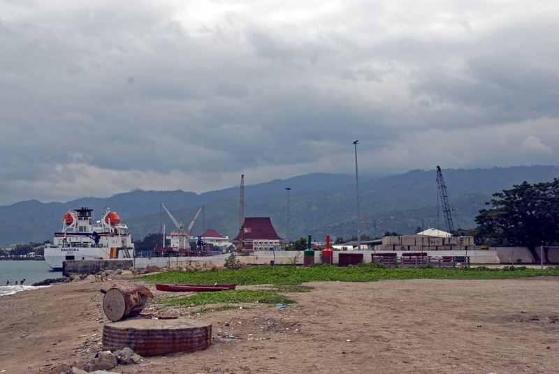 A boat and buildings near the Dili Harbor in East Timor
